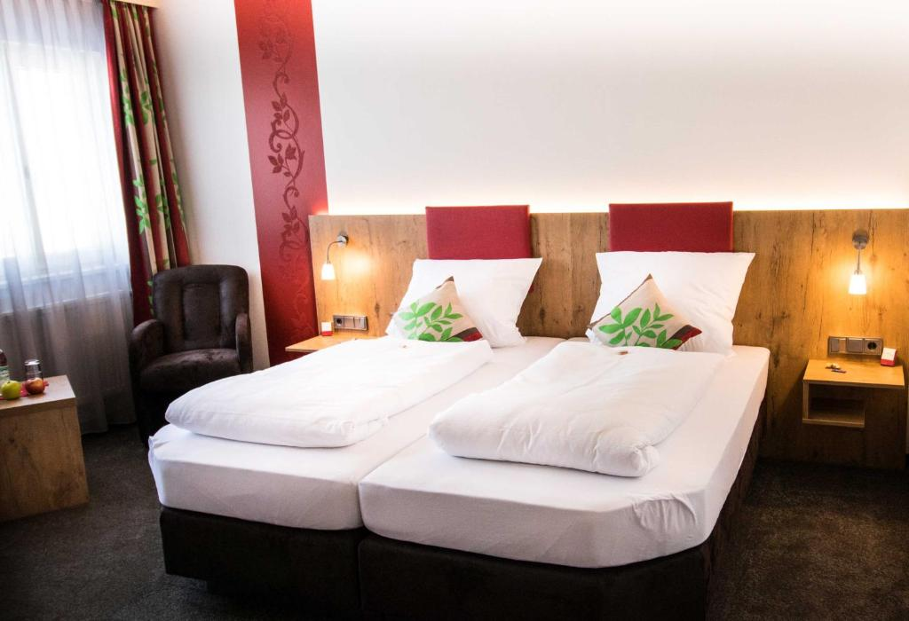 A bed or beds in a room at ROOM'Z zimmeraufzeit