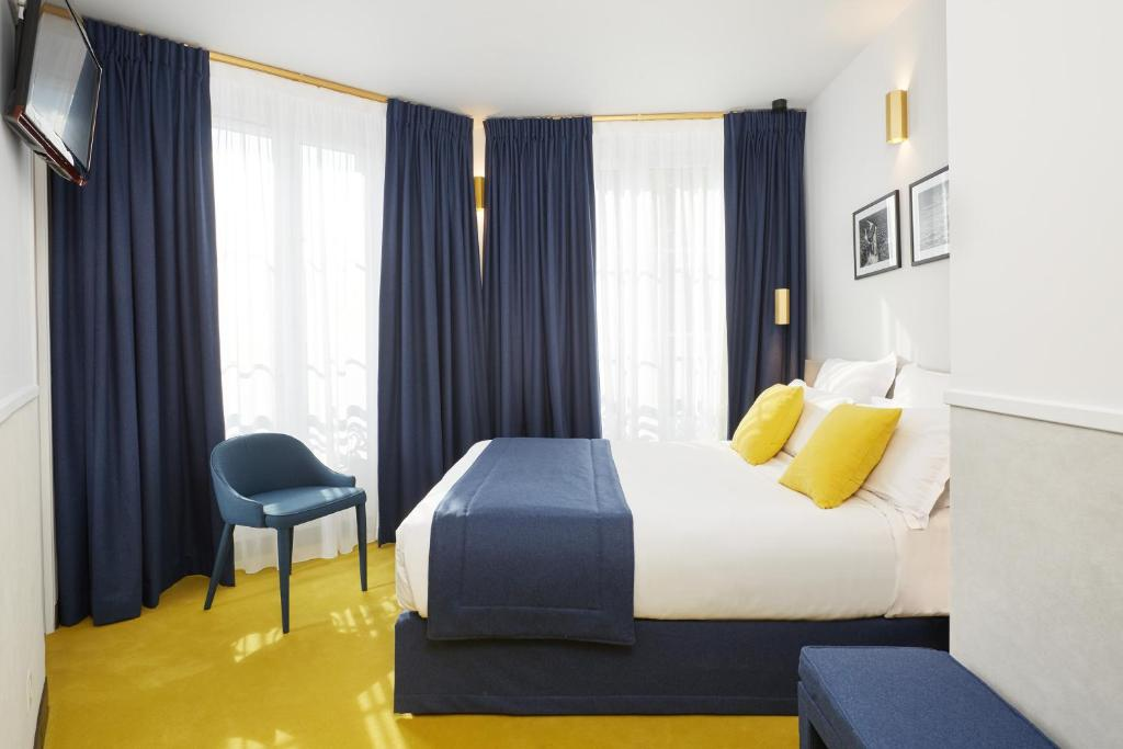 A bed or beds in a room at Edouard 6 Montparnasse