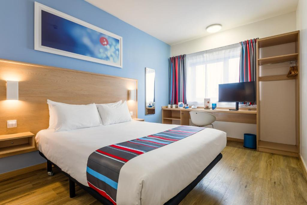 A bed or beds in a room at Travelodge Barcelona Fira