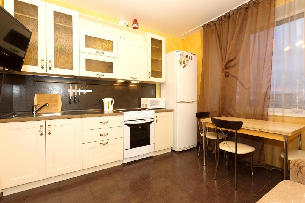 Кухня или мини-кухня в Апартаменты Белинского 36