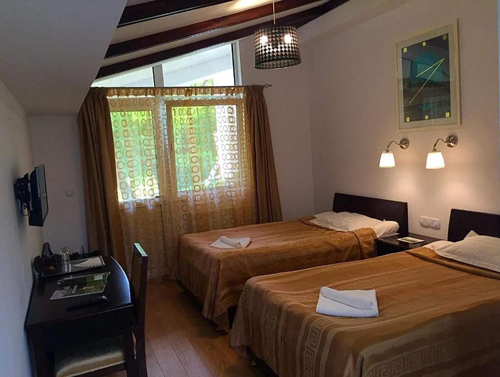A bed or beds in a room at Lac de Verde - Golf&Leisure Resort