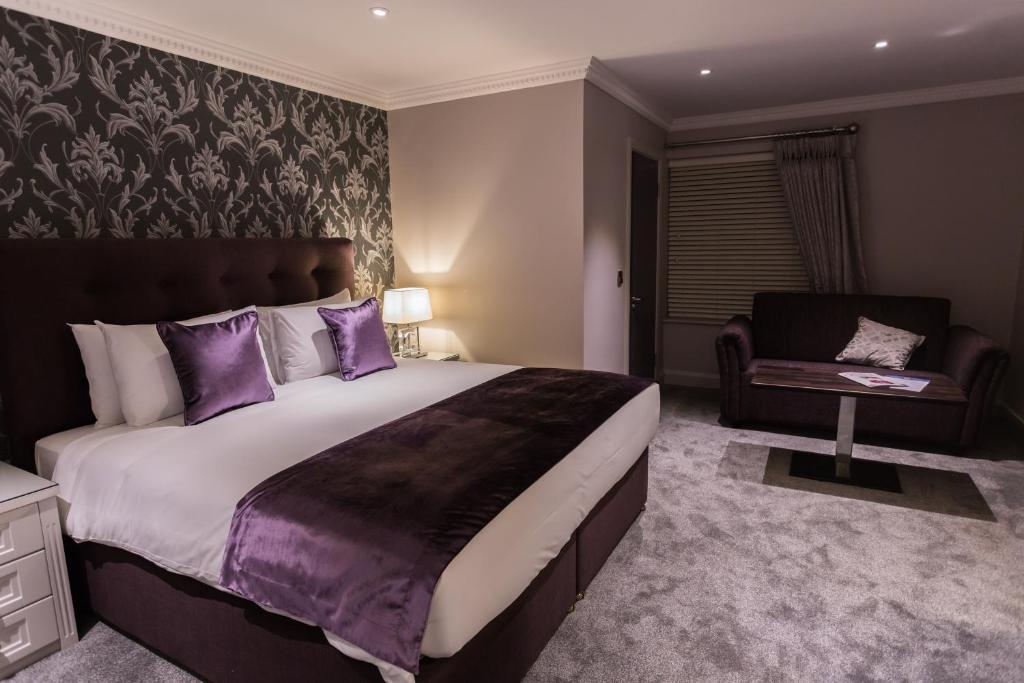 A bed or beds in a room at 12th lock Boutique Hotel