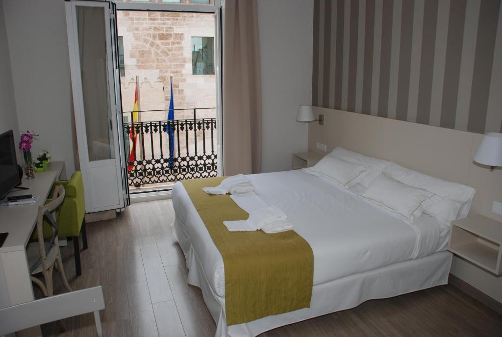 Кровать или кровати в номере Hotel San Lorenzo Boutique