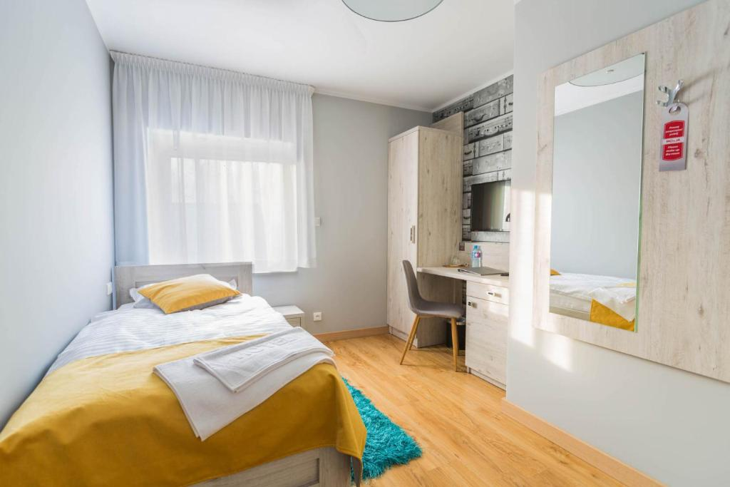 Łóżko lub łóżka w pokoju w obiekcie MOTEL MO&JA