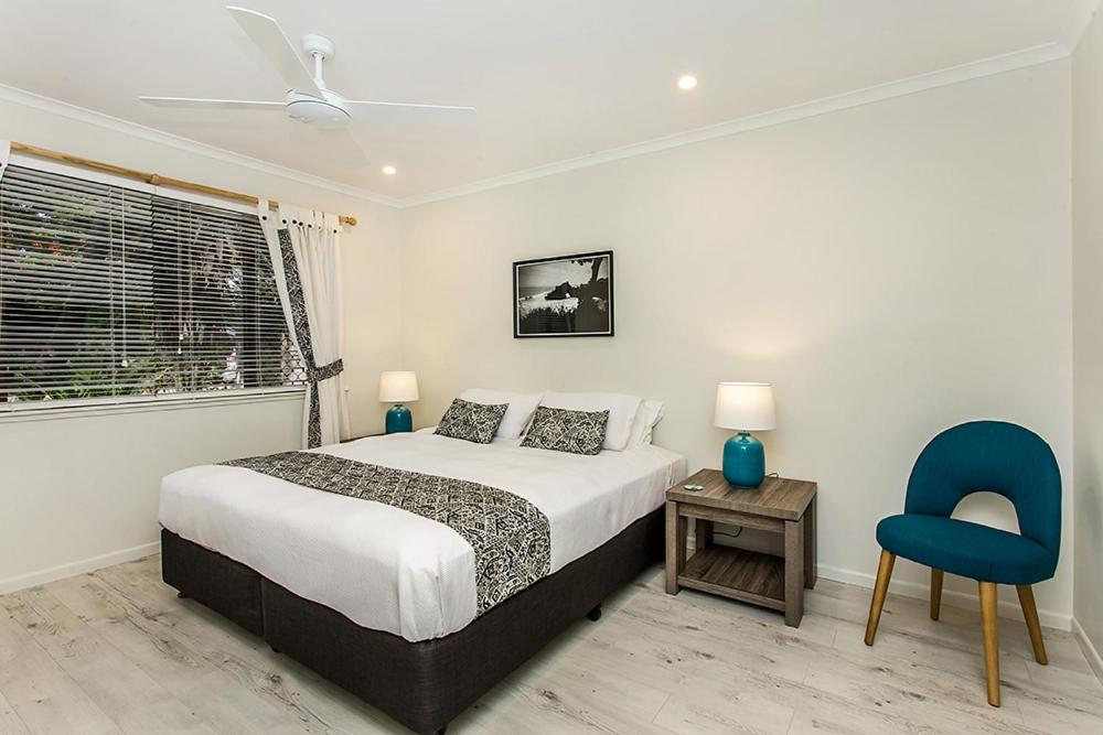 A bed or beds in a room at Woodlark Byron Bay
