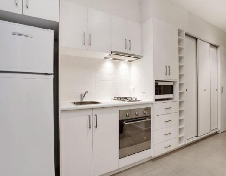 A kitchen or kitchenette at Glen Waverley Apartment