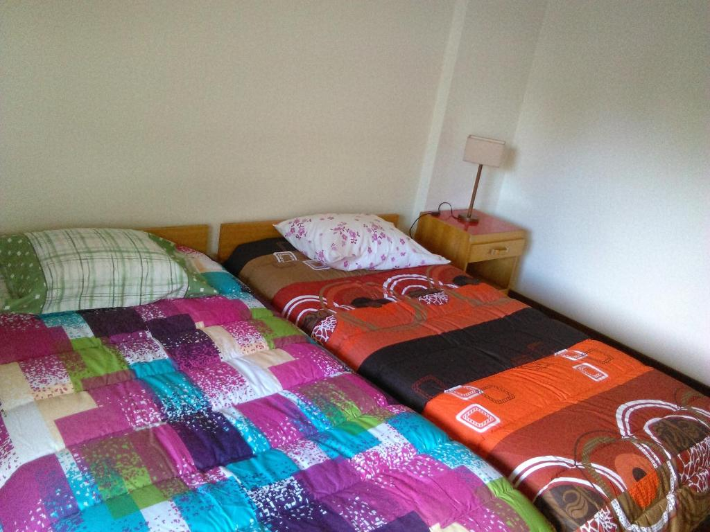 A bed or beds in a room at Apartamento Infante T3