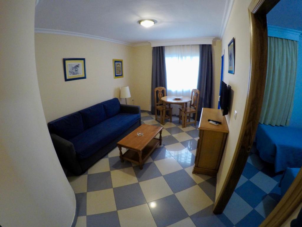 Zona de estar de Apartamentos Niña de Oro
