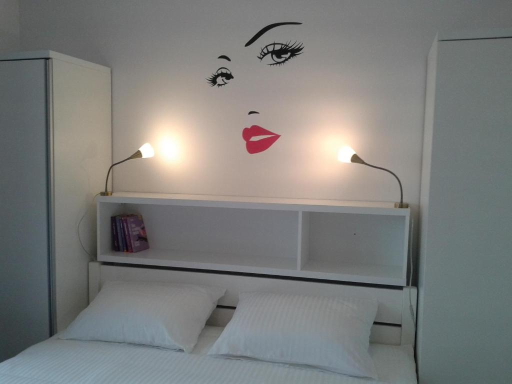 Łóżko lub łóżka w pokoju w obiekcie Apartament Solna 11 Kołobrzeg