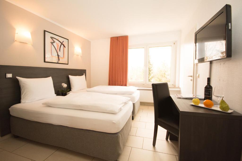 Кровать или кровати в номере BIVIUS eat&sleep