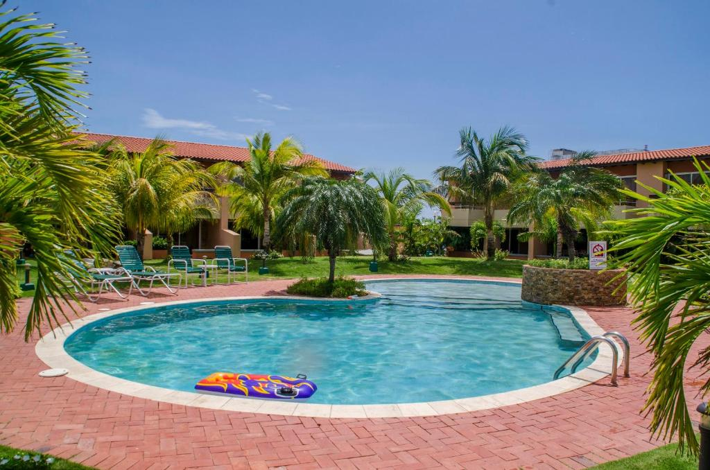 The swimming pool at or near Family-Flexication-Friendly Villa, few steps from Eagle Beach