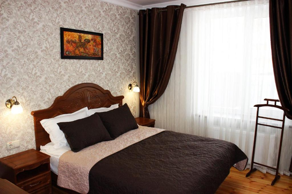 A bed or beds in a room at Villa Exclusive