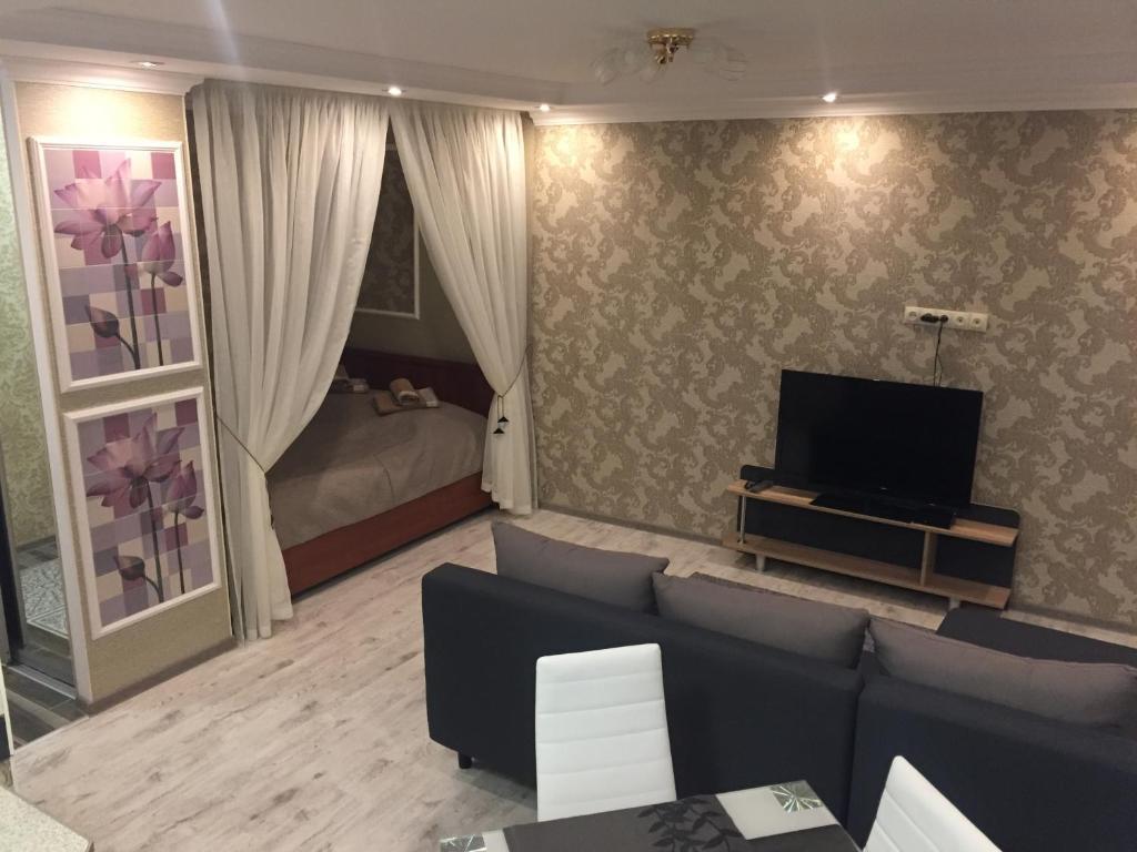 Телевизор и/или развлекательный центр в Apartment on Leninskiy 127