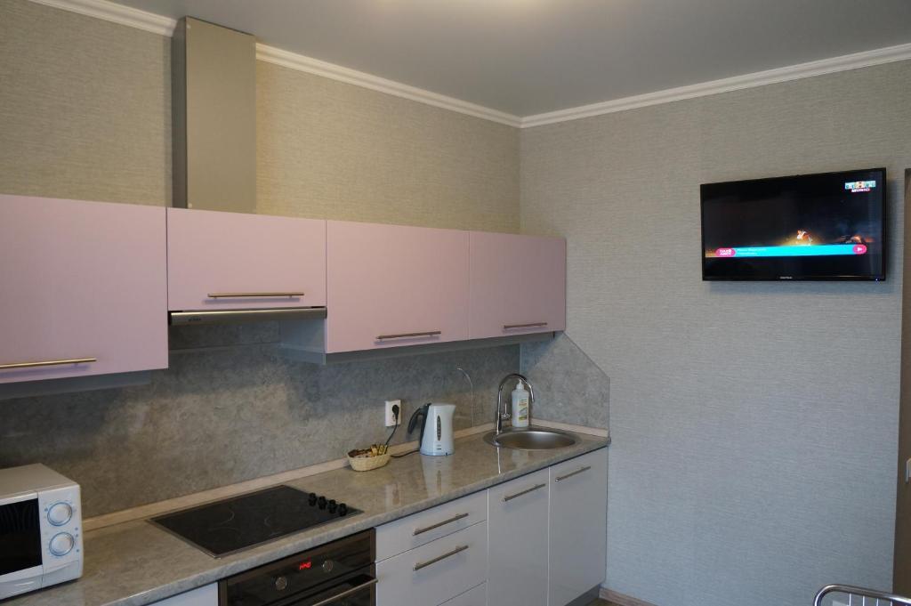 A kitchen or kitchenette at Apartment on Kirovskiy prospekt