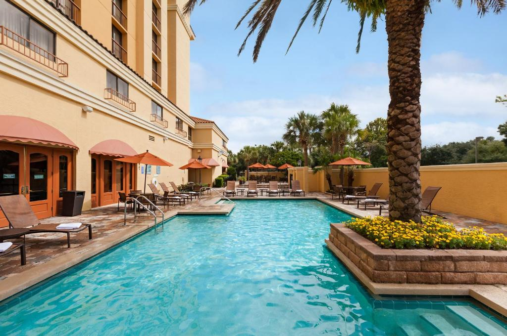 The swimming pool at or near Embassy Suites by Hilton Orlando International Drive Convention Center