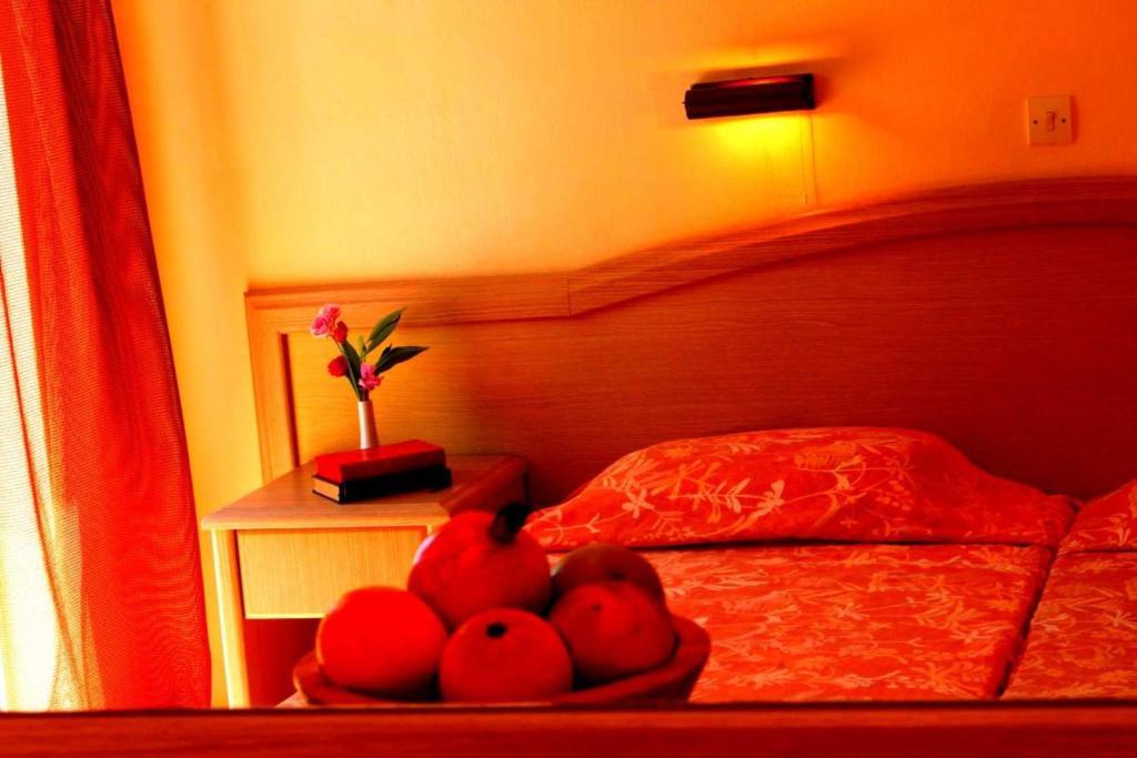 Ένα ή περισσότερα κρεβάτια σε δωμάτιο στο Primavera Hotel