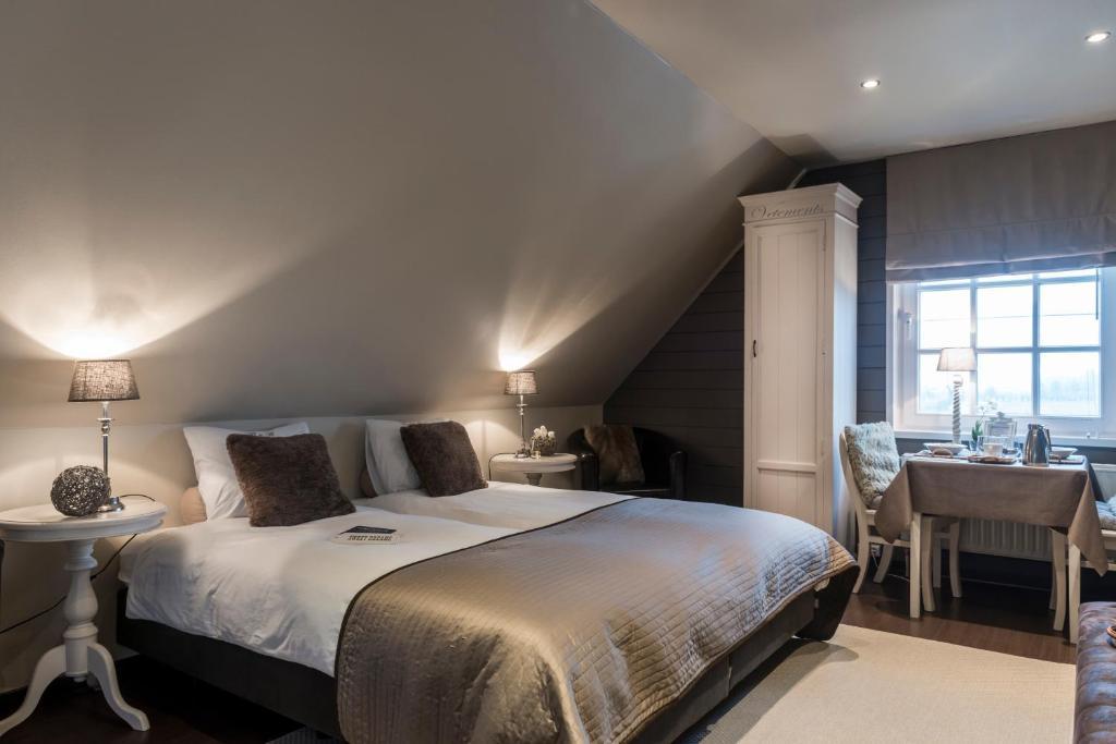 Een bed of bedden in een kamer bij B&B, apartments Casa-Cosi
