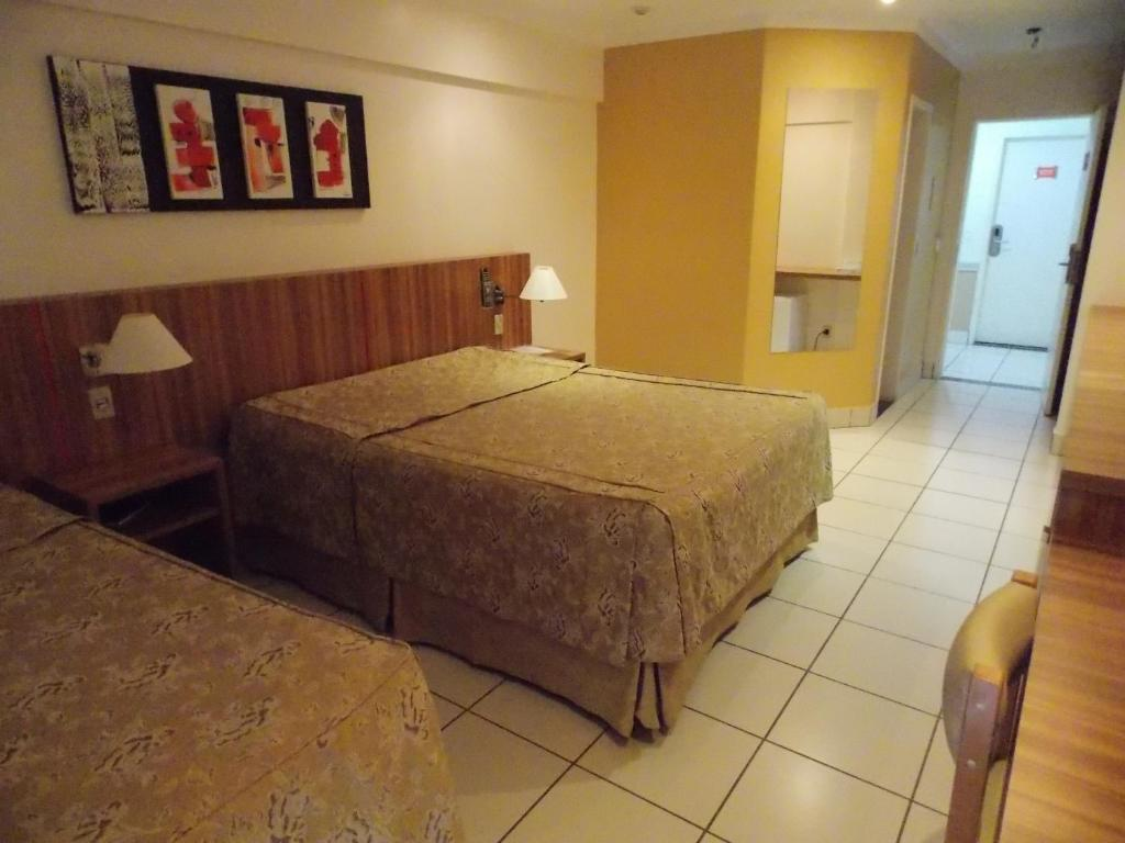 A bed or beds in a room at Via Caldas Exclusive