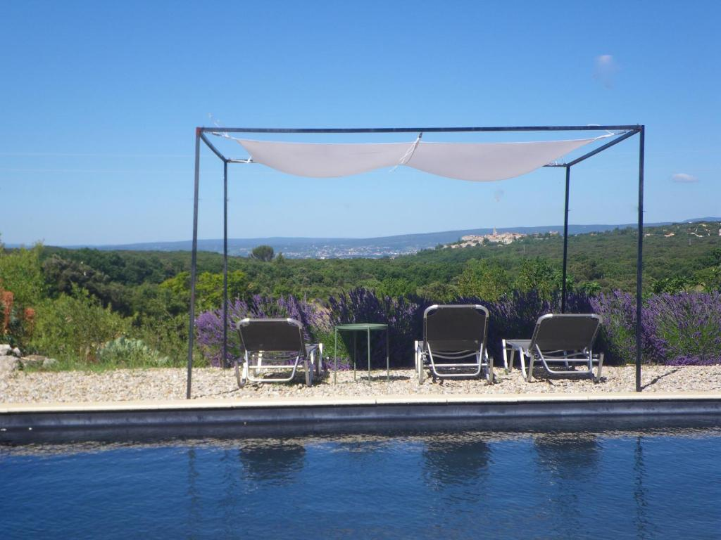 The swimming pool at or near Les Esplanes