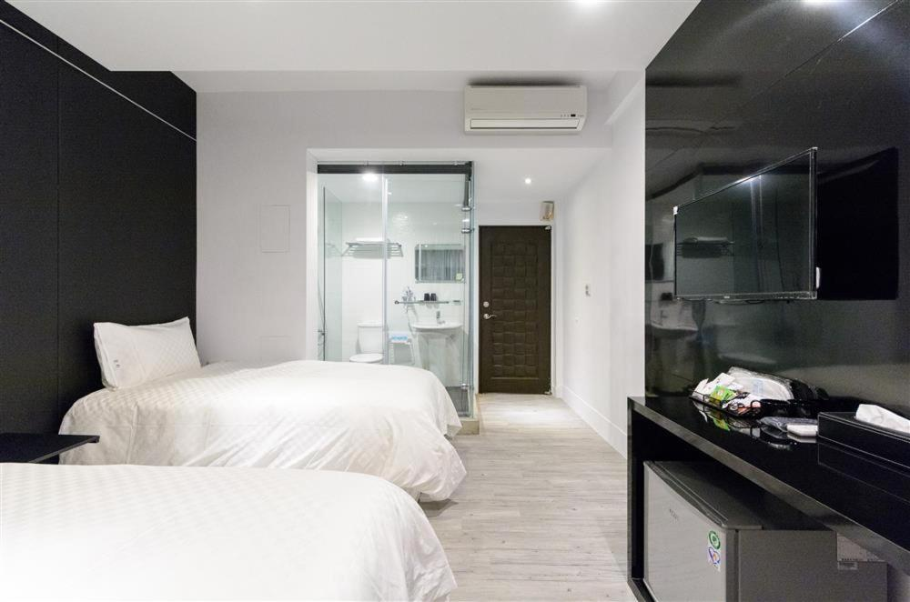 豆府民宿房間的床