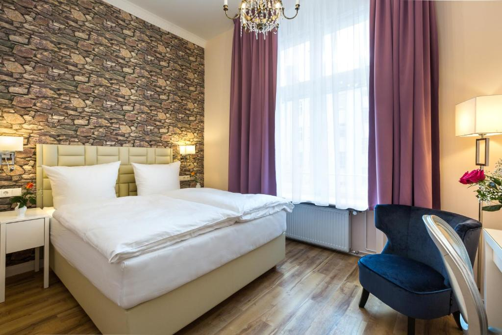 Ein Bett oder Betten in einem Zimmer der Unterkunft AMC Hotel - Schöneberg