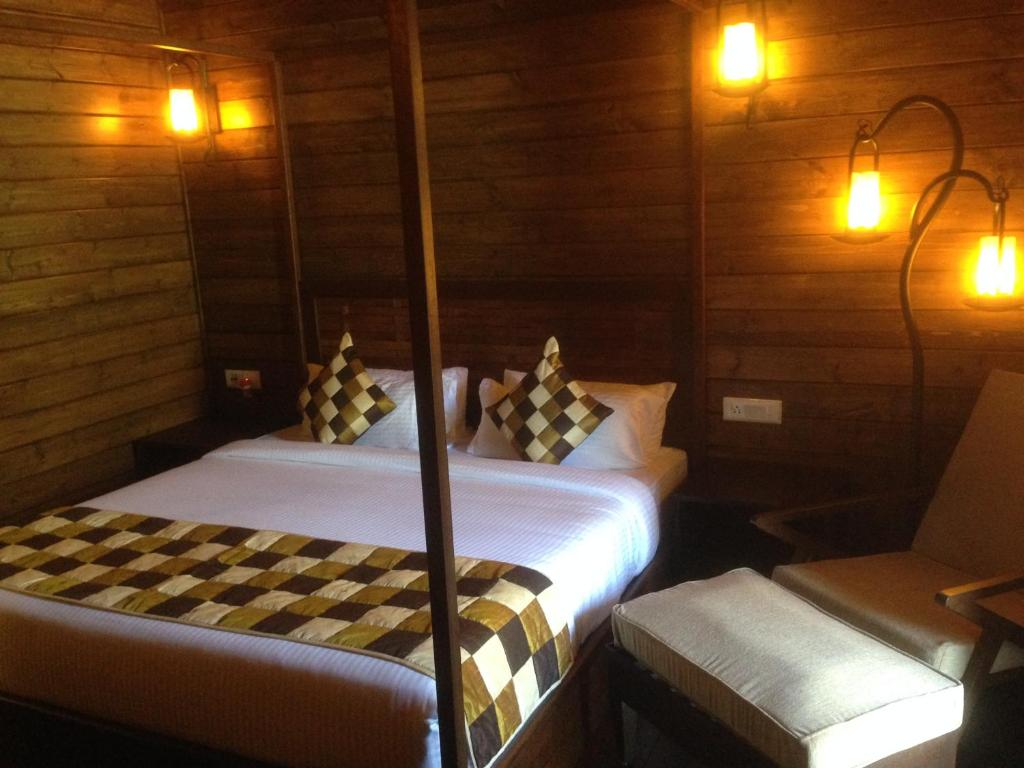 A bed or beds in a room at TSG Aura