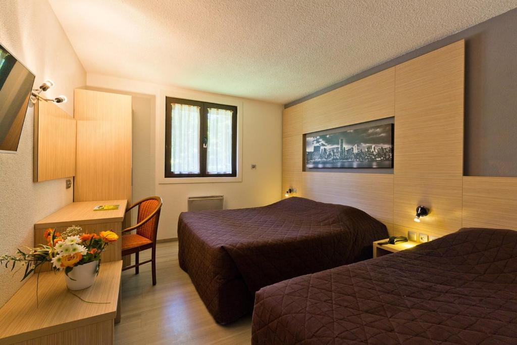 Un ou plusieurs lits dans un hébergement de l'établissement Albhotel Grill