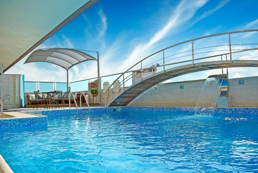 The swimming pool at or near Principal New Leisure Hotel