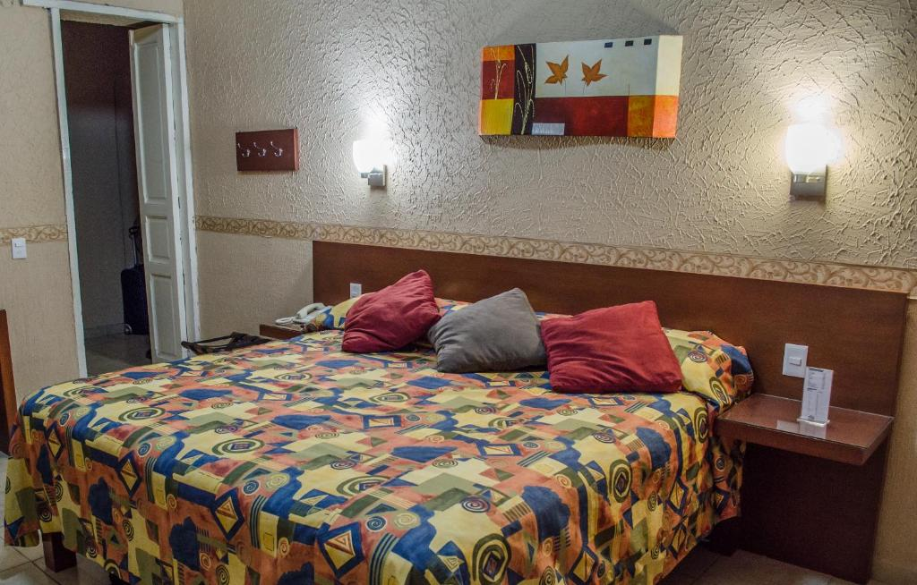 Cama o camas de una habitación en Hotel Posada Regis