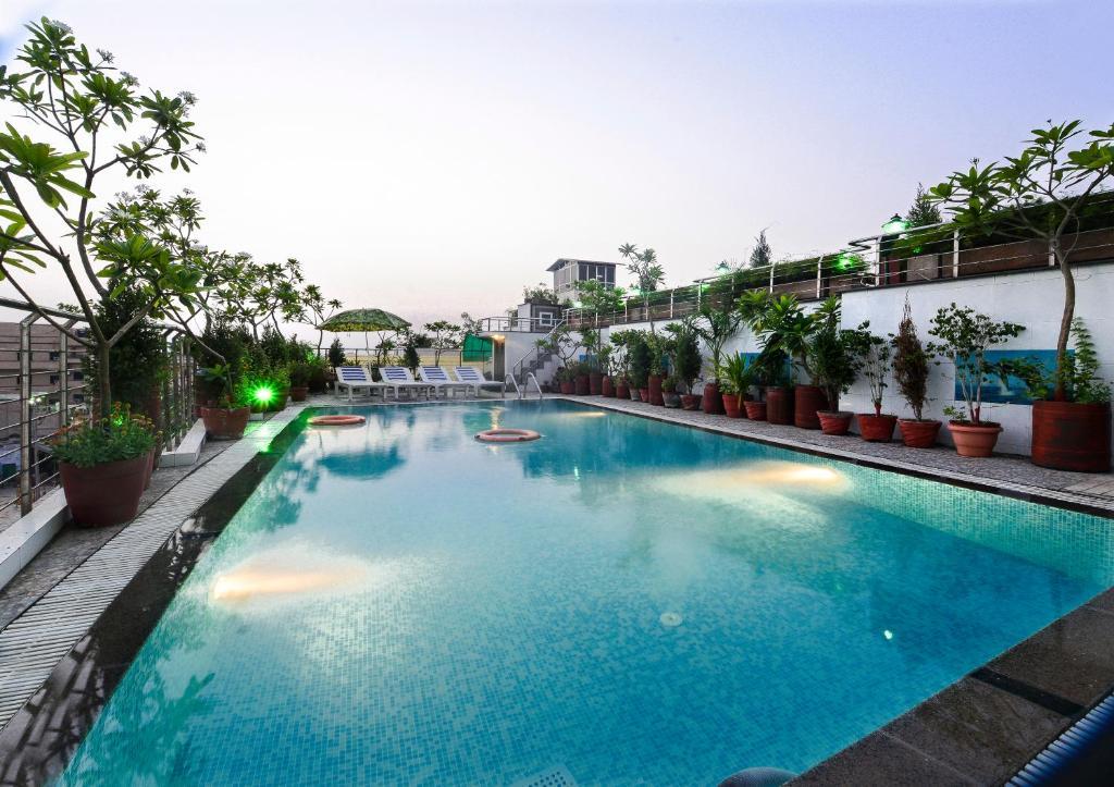 The swimming pool at or near Hotel Taj Resorts