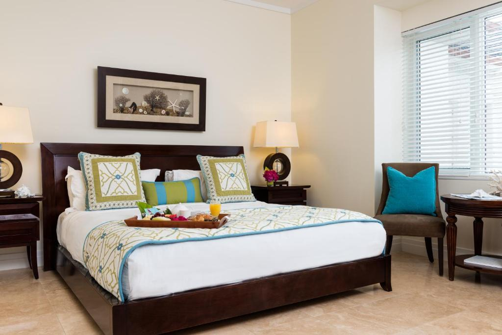 A bed or beds in a room at West Bay Club