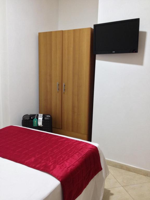 A television and/or entertainment center at San Paolo Guest House