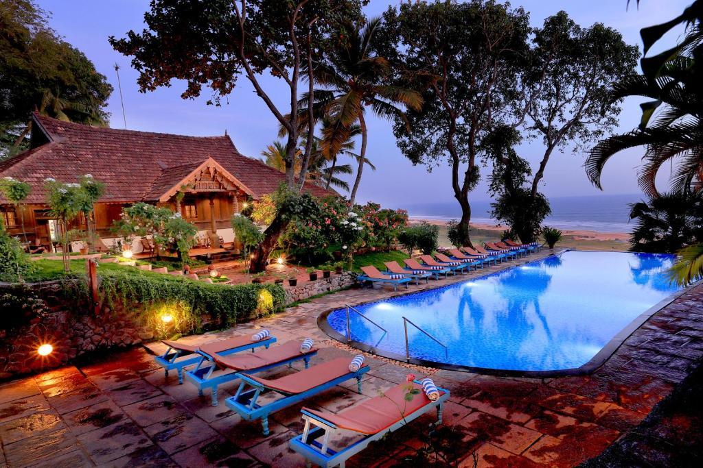 The swimming pool at or near Somatheeram Ayurveda village