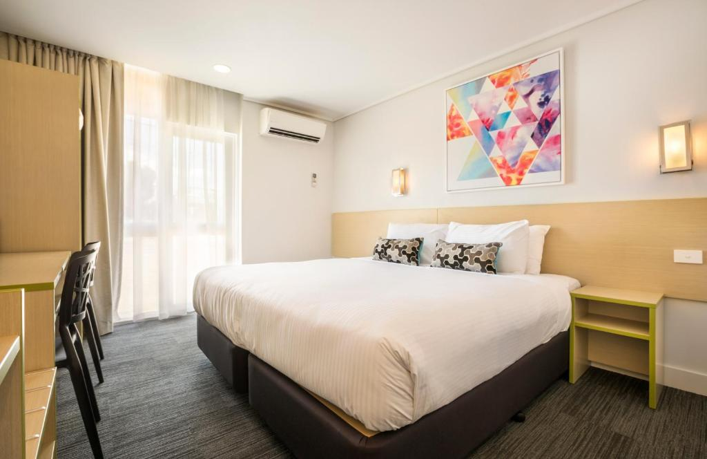 A bed or beds in a room at Nightcap at Coolaroo Hotel