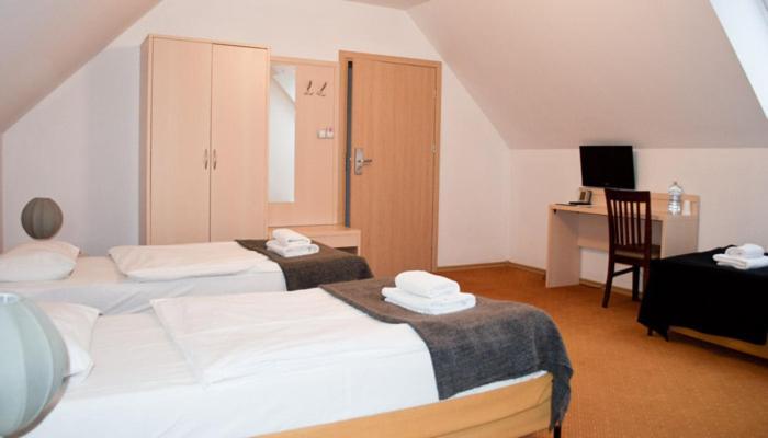 Łóżko lub łóżka w pokoju w obiekcie Zdrojówka SPA