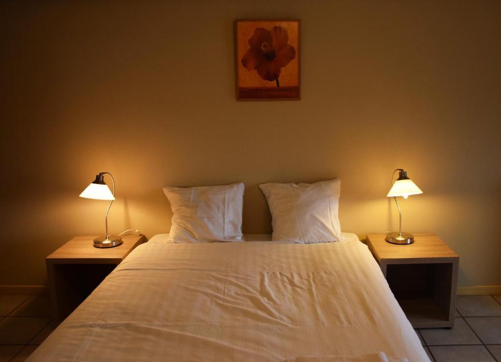 Ein Bett oder Betten in einem Zimmer der Unterkunft Condo Gardens Antwerp