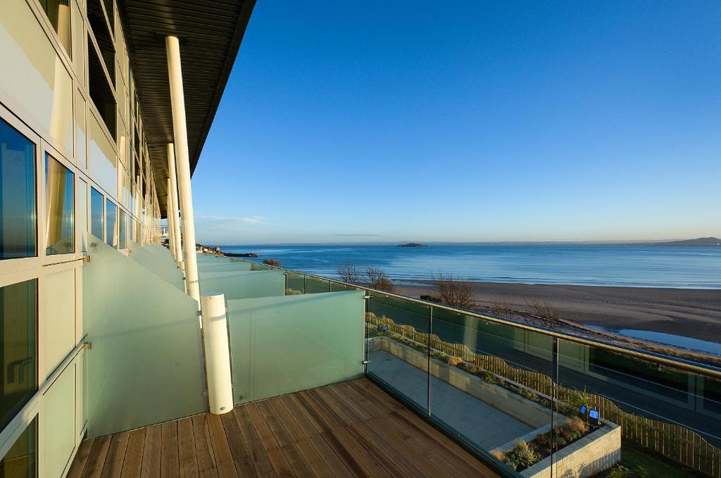 A balcony or terrace at The Bay Hotel
