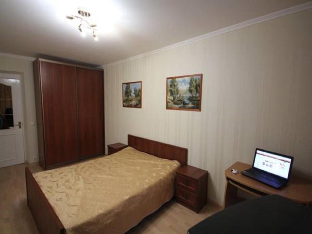 Кровать или кровати в номере Apartment Prospekt Mira 182