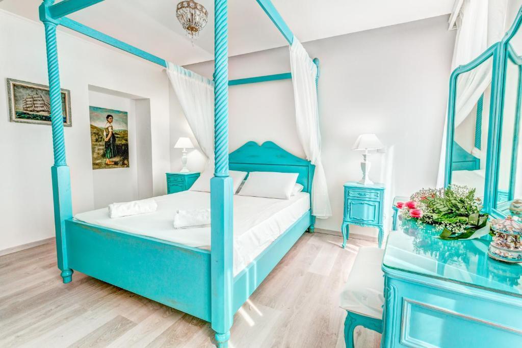 Un ou plusieurs lits dans un hébergement de l'établissement Belone Suite
