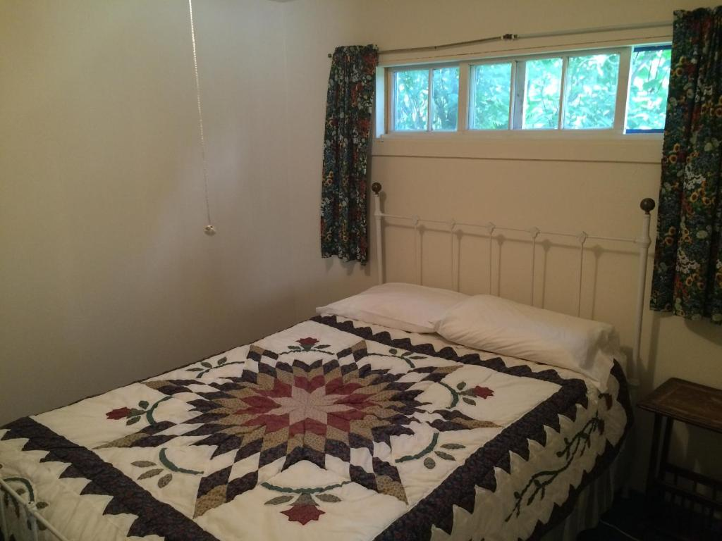 A bed or beds in a room at Inn at the Isles