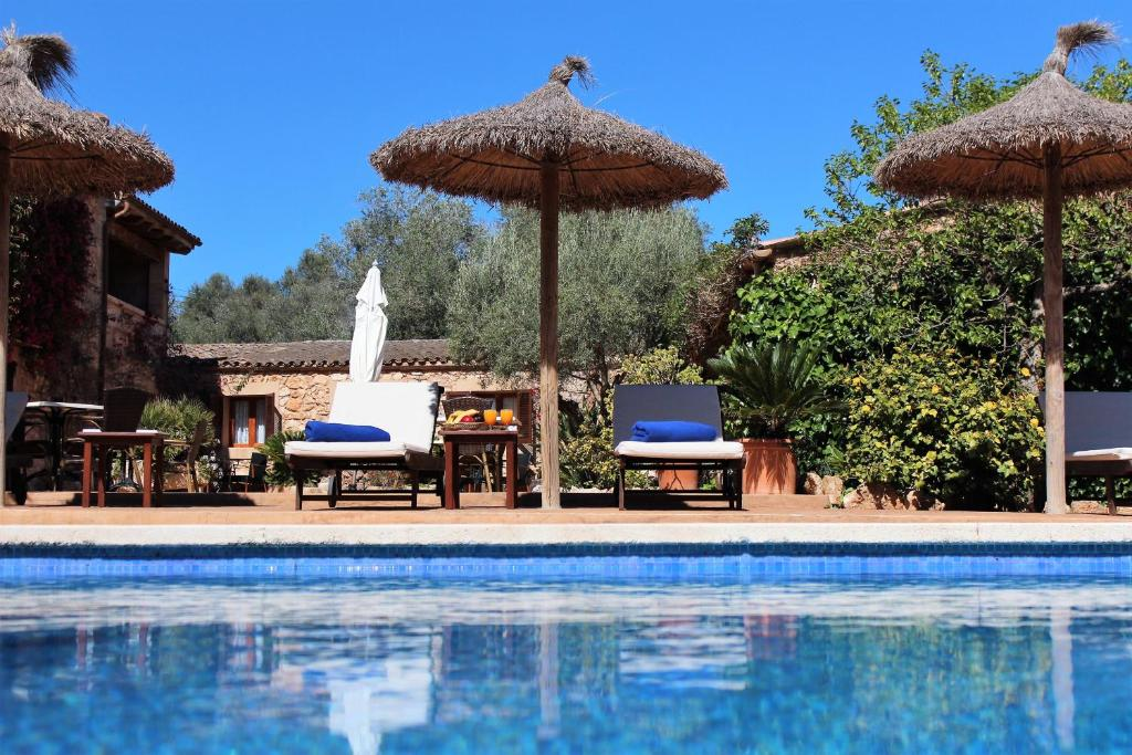 The swimming pool at or near Finca Es Torrent