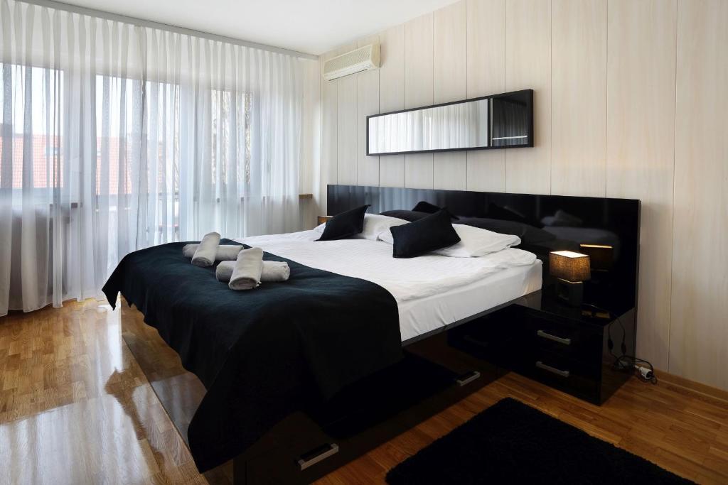 Krevet ili kreveti u jedinici u objektu Apartment Check in