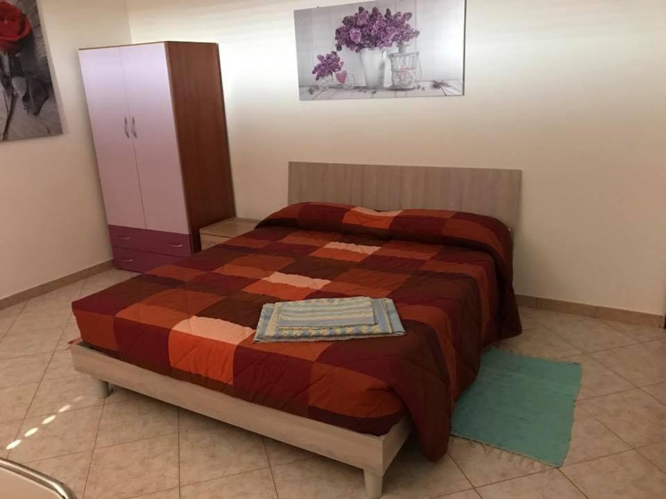 A bed or beds in a room at Casa Vacanza Villaggio Solaris