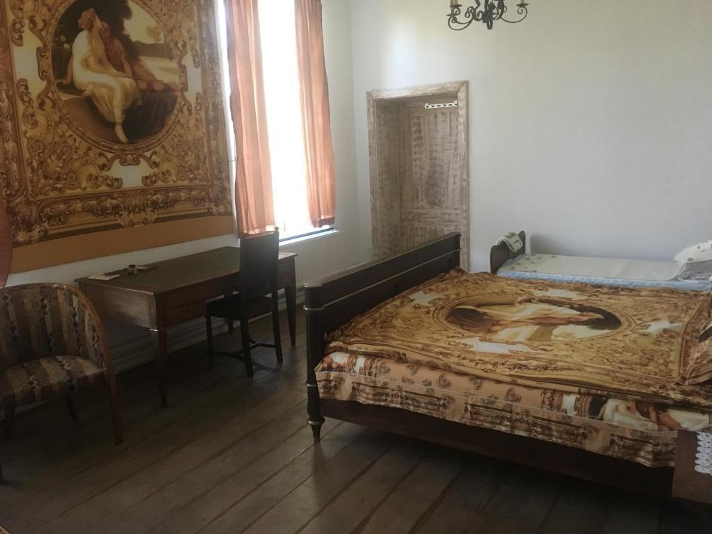 A bed or beds in a room at Château De L'enclos