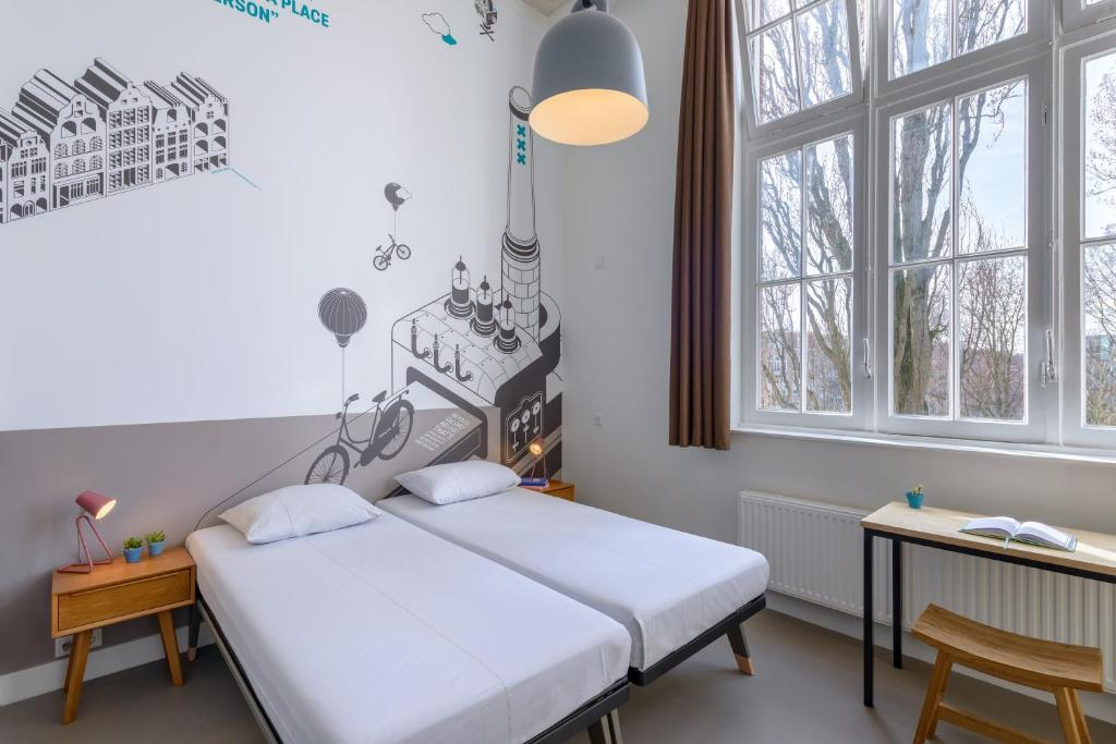 A bed or beds in a room at Stayokay Amsterdam Oost