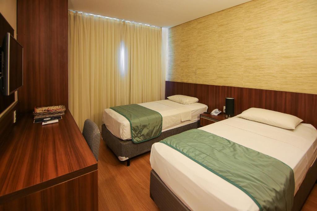 Cama ou camas em um quarto em Hotel Serrano
