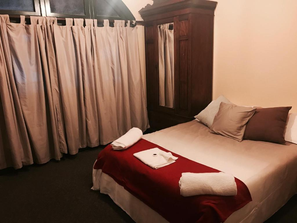 A bed or beds in a room at Bellbird Hotel