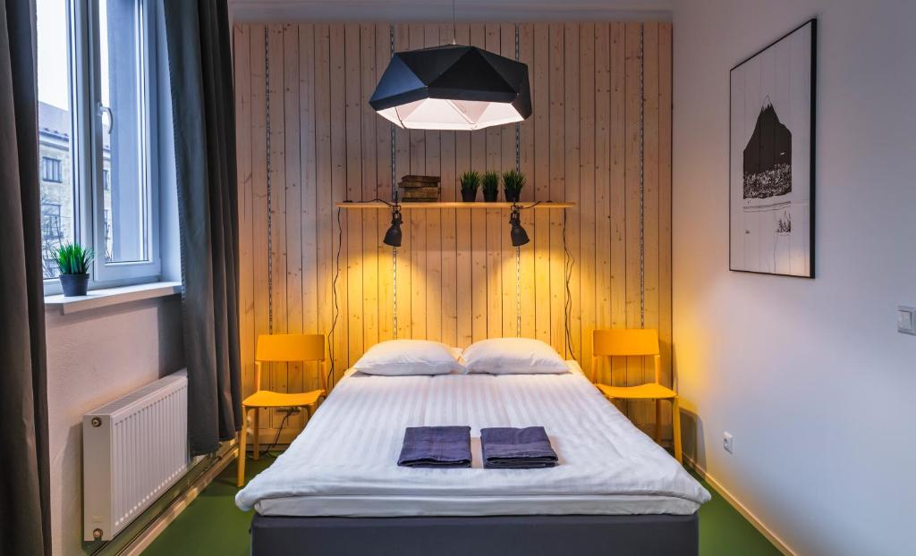 A bed or beds in a room at Hektor Design Hostel