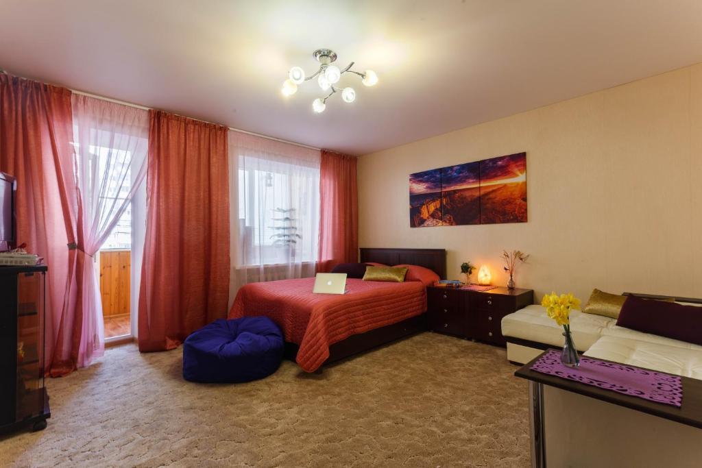 Кровать или кровати в номере Cozy-Mozy Apartment