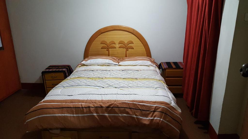 A bed or beds in a room at Andescamp Hostel